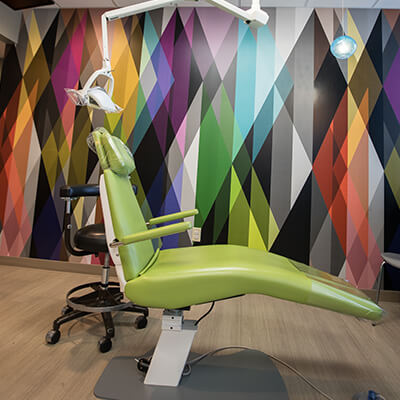 Our comfortable chairs and vibrant colors at our Carmel pediatric dentist office.