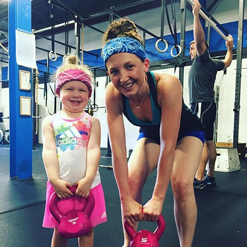 Dr. Juntgen, a Carmel pediatric dentist, a her young daughter, working out at the gym