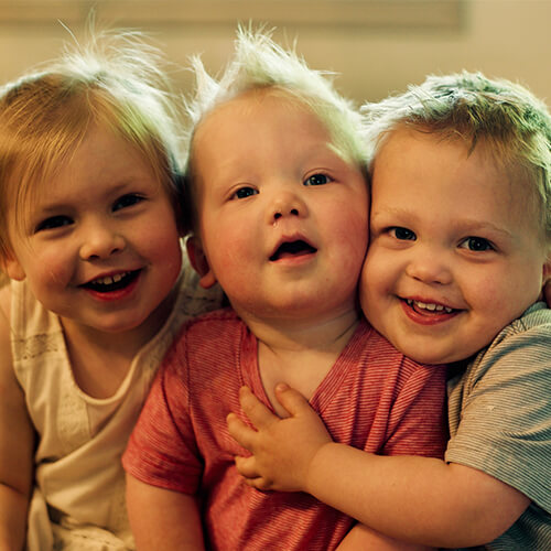 Three adorable toddlers who are patients of Dr. Juntgen, a Carmel pediatric dentist,