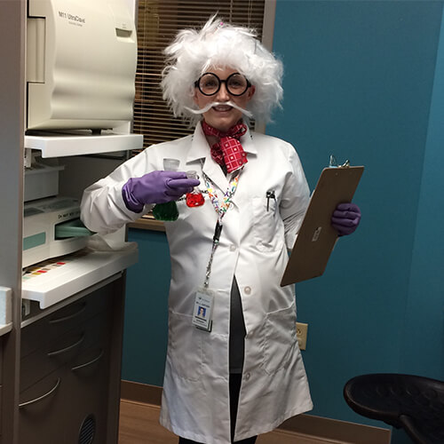 Dr. Juntgen, a Carmel pediatric dentist, dressed as a mad scientist to celebrate Halloween at her Indiana dentist office.